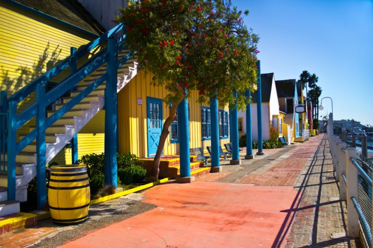 Fisherman's Village has colorful storefronts and a wide brick walk in Marina Del Rey, California.