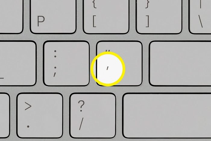 close up of computer keyboard with apostrophe key highlighted