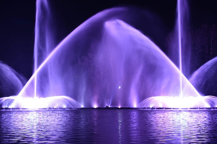 "Musical fountain with laser animations. Night laser fountain show, on the Roshen embankment, the Ukrainian city of Vinnitsa.Musical fountain ""Roshen"" in Vinnitsa, Ukraine.Evening show Roshen fountain."
