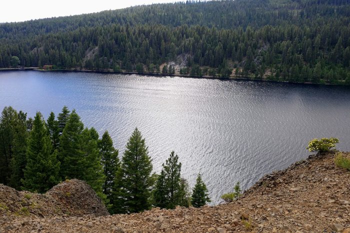 Scenic view of Payette Lake, mountains and trees from Ponderosa State Park in McCall Idaho