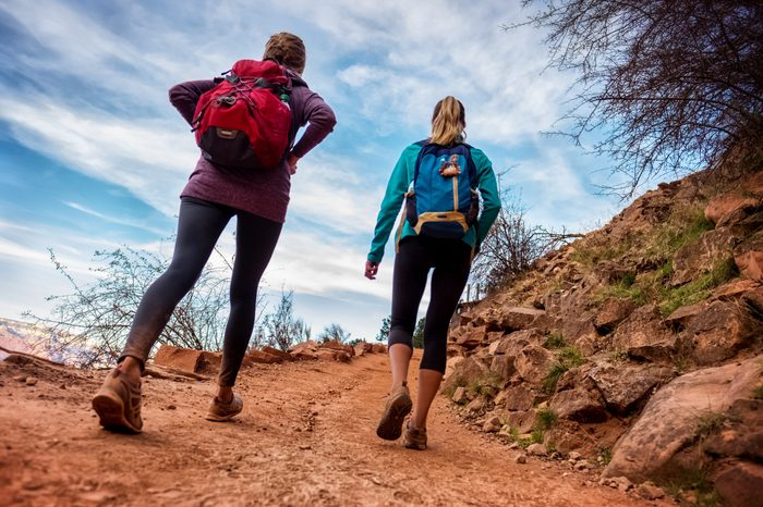 Two lady hiker on the walkway at the Grand Canyon National Park, USA