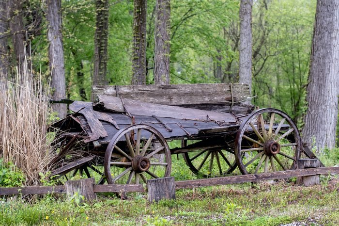 Vintage wood wagon is falling apart in a rural Indiana field, but still stands as a part of travel history