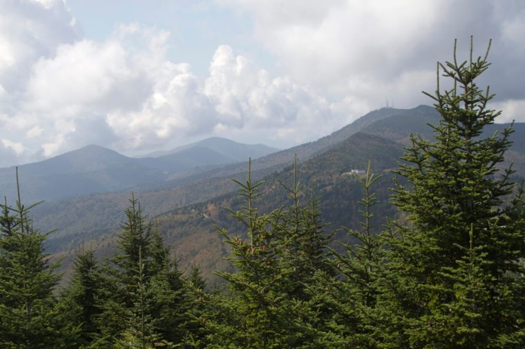 Cloudy weather over the scenic Appalachian Mountains and Pisgah National Forest as seen from Mount Mitchell State Park in western North Carolina, the highest point east of the Mississippi