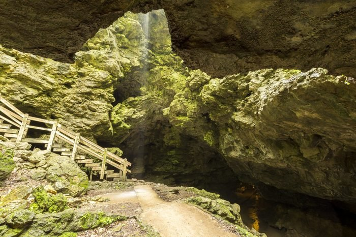Wet Cave Entrance / A cave entrance with a small waterfall that formed during a rain storm.