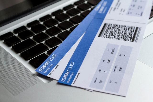 Airline tickets over the keyboard of a laptop