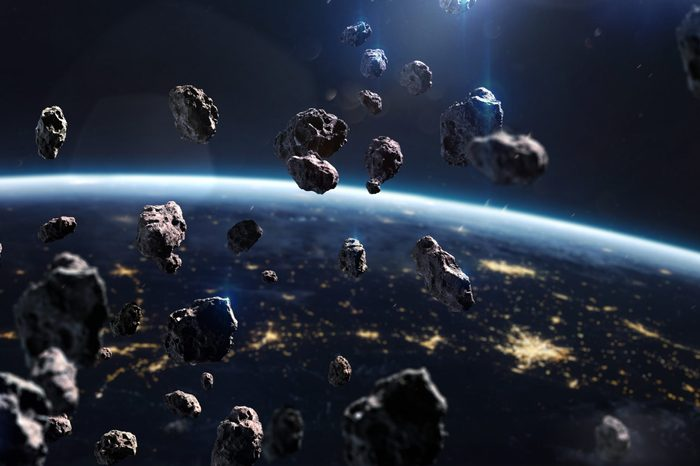 Asteroids near Earth. Meteorites orbiting planet. Deep space image, science fiction fantasy in high resolution ideal for wallpaper and print. Elements of this image furnished by NASA