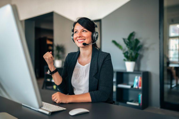 Beautiful female customer service representative answer client's questions.
