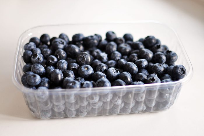 A box of delicious ripe blueberries. Organic, diet food. Berries in a plastic container.