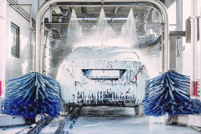detail view on car wash, car wash foam water, Automatic car wash in action