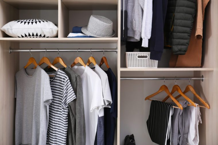 Stylish clothes and home stuff in large wardrobe closet