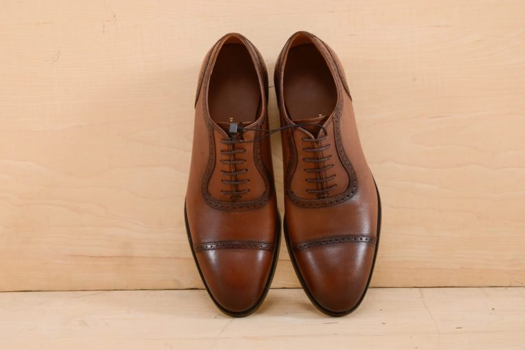 Set of men's shoes. Wooden background