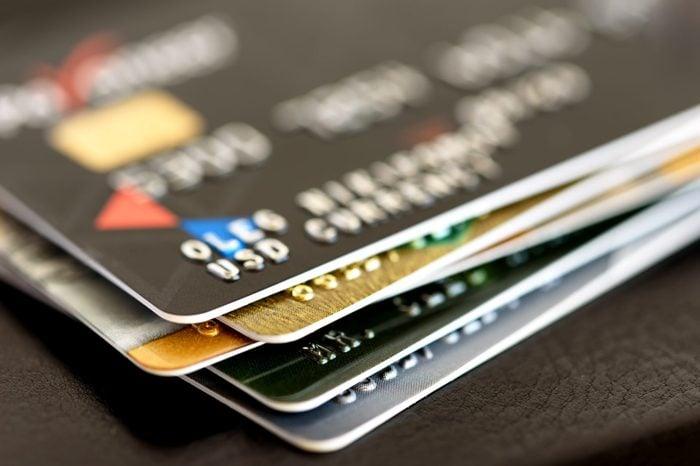 Credit card close-up. Plastic card on black background
