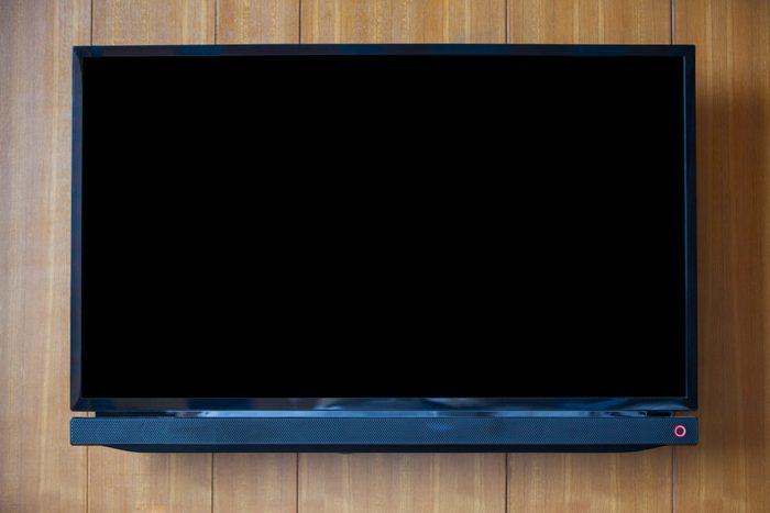 TV on wood background.