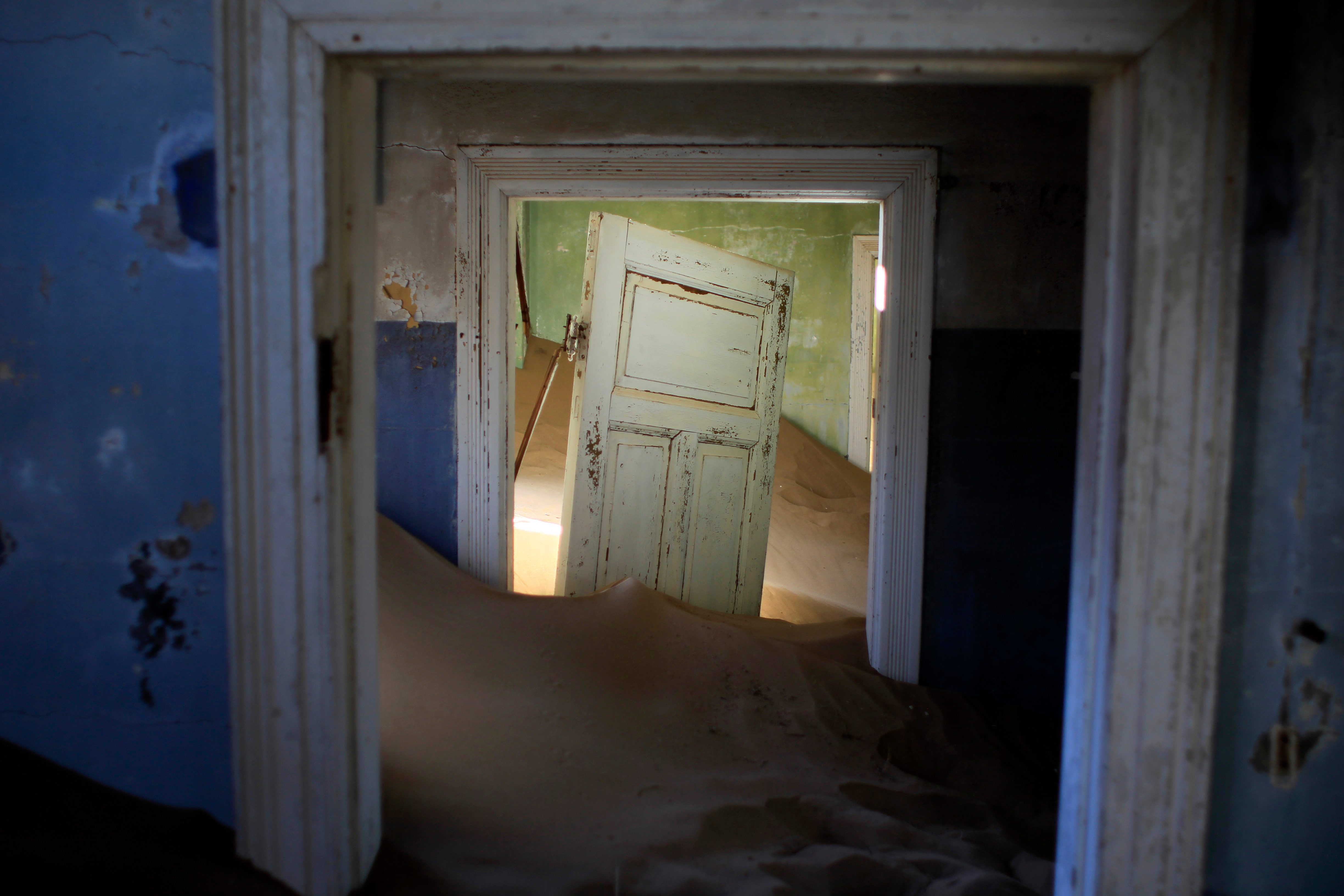 Mandatory Credit: Photo by Jerome Delay/AP/Shutterstock (9584292a) Sand fills an abandoned house in Kolmanskop, Namibia. Kolmanskop, was a diamond mining town south of Namibia, build in 1908 and deserted in 1956. SInce then, the desert slowly reclaims its territory, with sand invading the buildings where 350 German colonists and more than 800 local workers lived during its hay-days of the 1920s Evergreen Enterprise World Abandoned Places Photo Gallery, Kolmanskop, Namibia - 23 Jul 2013