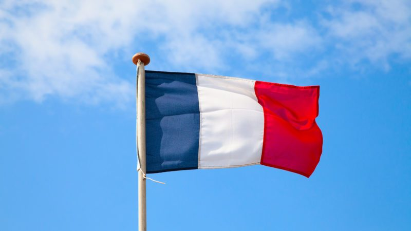 French flag in the blue sky