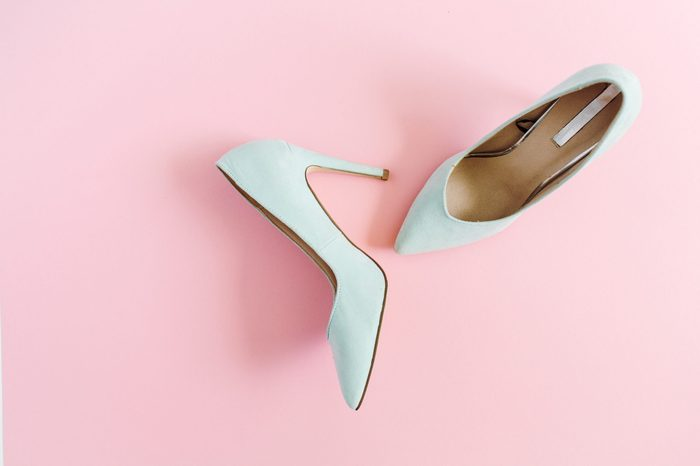 Fashion blog look. Pastel blue women high heel shoes on pink background. Flat lay, top view trendy beauty female background.
