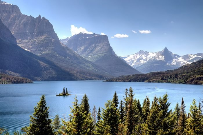 Scenic view of Saint Mary Lake with snow capped mountains in background