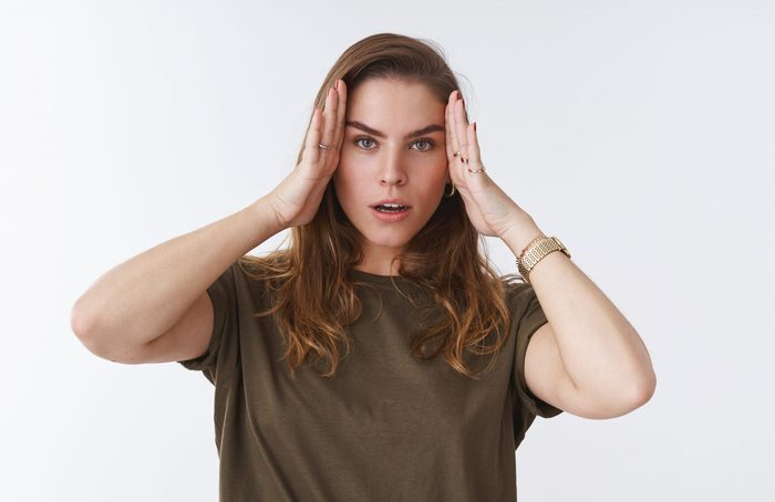 Head goes round enough. Portrait bothered fed up woman exhausted head aches feeling painful migraine suffering headache blood pressure rising, discomfort temples, standing white background