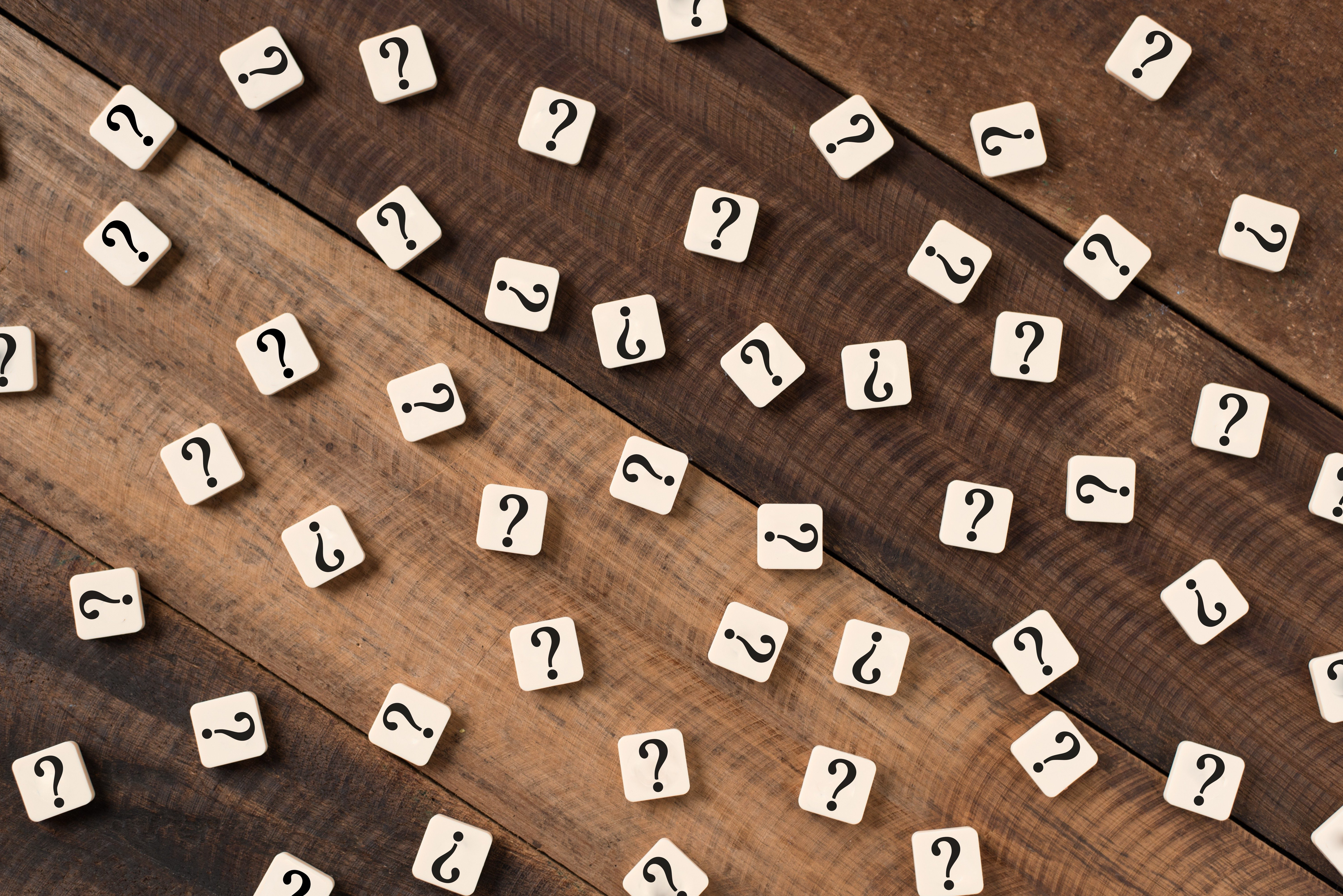 Question mark on alphabet tiles. question mark on wooden table background
