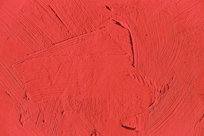 Painting close up red texture for interesting, creative, imaginative backgrounds.