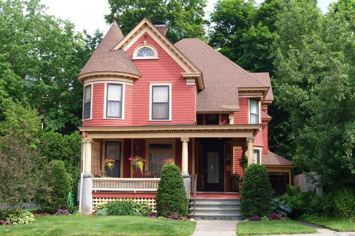 Beautiful Queen Anne style Victorian house surrounded by mature trees