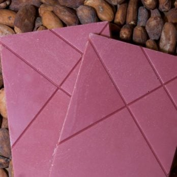 The new ruby chocolate on cocoa beans.