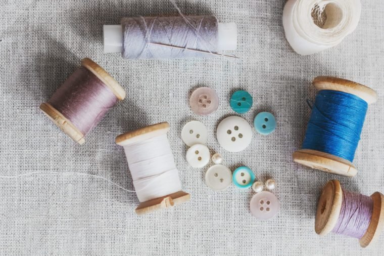 Sewing kit. Thread, needles and buttons.