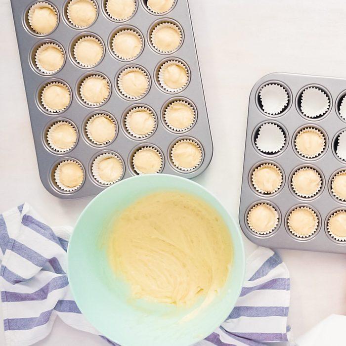 Flat lay. Scooping vanilla cupcake batter into cupcake liners.; Shutterstock ID 1235337202; Job (TFH, TOH, RD, BNB, CWM, CM): TOH