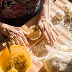 Senior woman hands rolling out dough in flour with rolling pin in her home kitchen; Shutterstock ID 295375742; Job (TFH, TOH, RD, BNB, CWM, CM): TOH