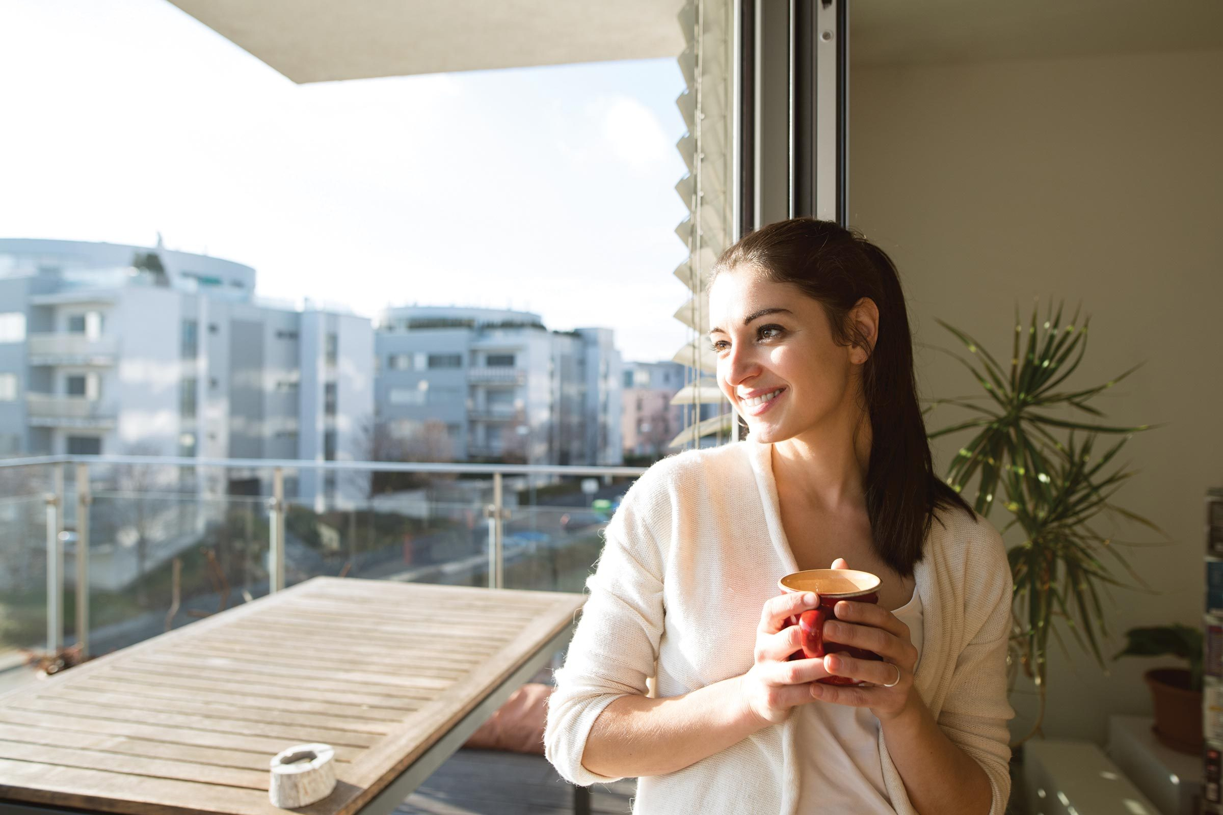 woman relax cup balcony sun