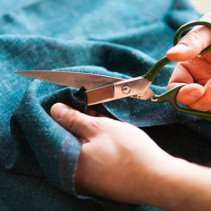 Tailor. Man Hands notch tailor tailor's scissors cloth. Close Up.; Shutterstock ID 624499169; Job (TFH, TOH, RD, BNB, CWM, CM): TOH