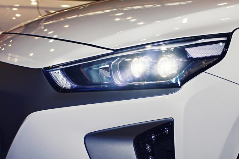 The headlight of the car is close-up. New car
