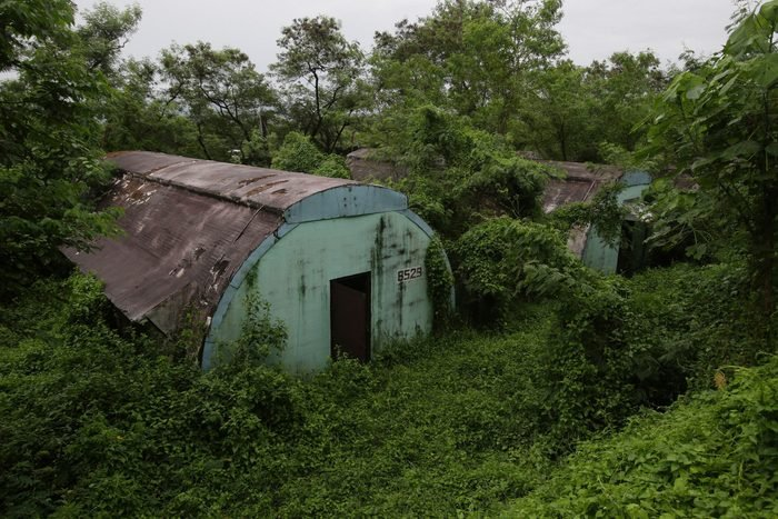 """Mandatory Credit: Photo by Aaron Favila/AP/Shutterstock (6743733b) A row of concrete structures called """"Quonset huts"""" lie inside the Subic Bay Freeport Zone, Zambales province, northern Philippines. The huts were used as barracks for U.S. Marines inside the former American naval base. It was closed in 1992 after the Philippine Senate voted not to extend the lease on the facility. Some of the abandoned huts were reused as dormitories and staff houses for employees. Other abandoned huts have not been touched since U.S. forces left 22 years ago Evergreen Enterprise World Abandoned Places Photo Gallery, Subic, Philippines"""