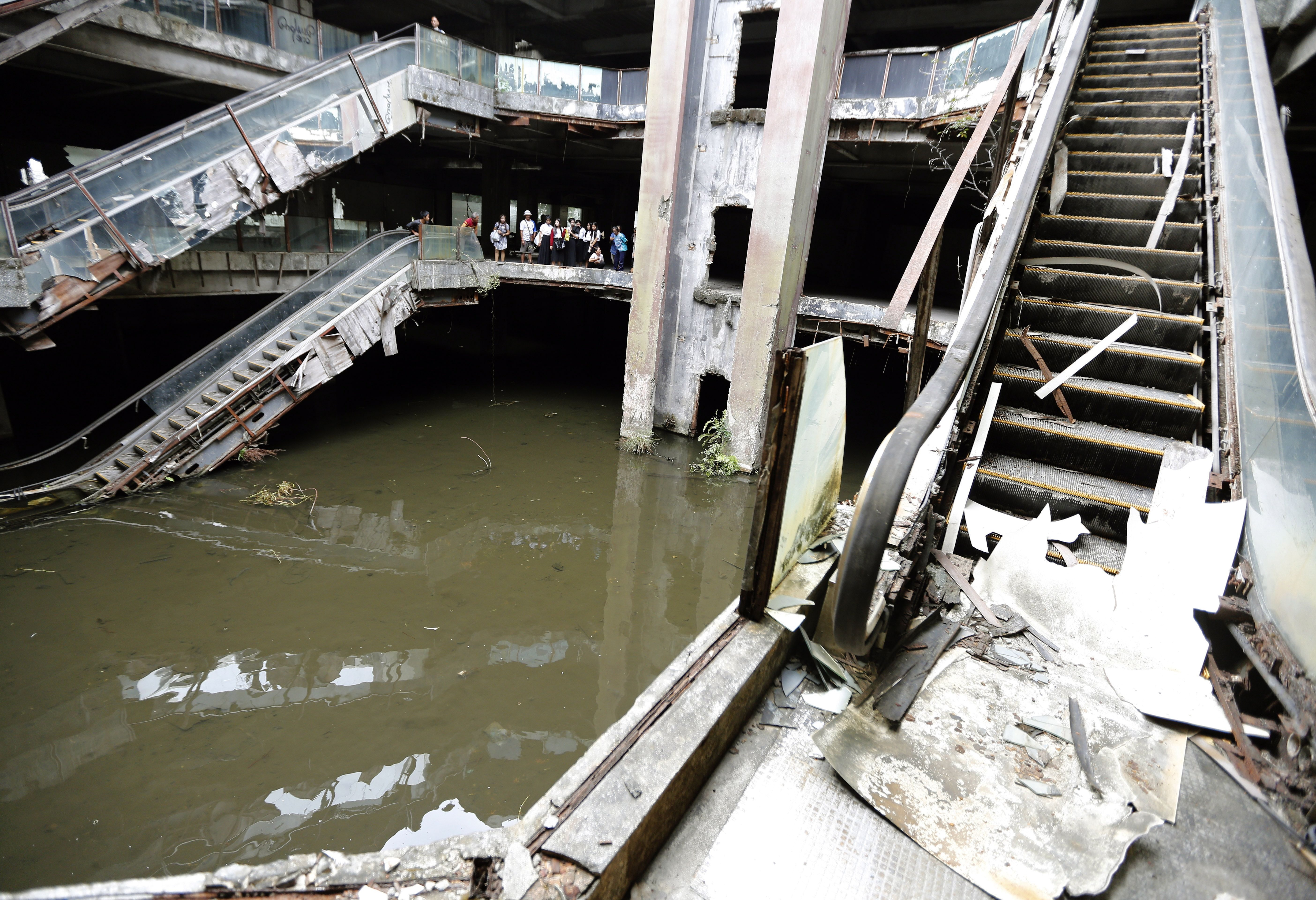 Mandatory Credit: Photo by Narong Sangnak/EPA/Shutterstock (7966551i) Thai Visitors Look For Fish in the Basement of an Abandoned Mall in Bangkok Thailand 13 January 2015 the Officers Are Moving Thousands of Fish Including Tilapia Iridescent Shark and Carp From a Pond of the New World Mall Before Its Demolition the Mall was Closed in 1997 After It was Found to Have Breached Building Regulations in Bangkok and It Has Become Home to Fish After It was Slowly Flooded by Rain Water Thailand Bangkok Thailand Fishing - Jan 2015