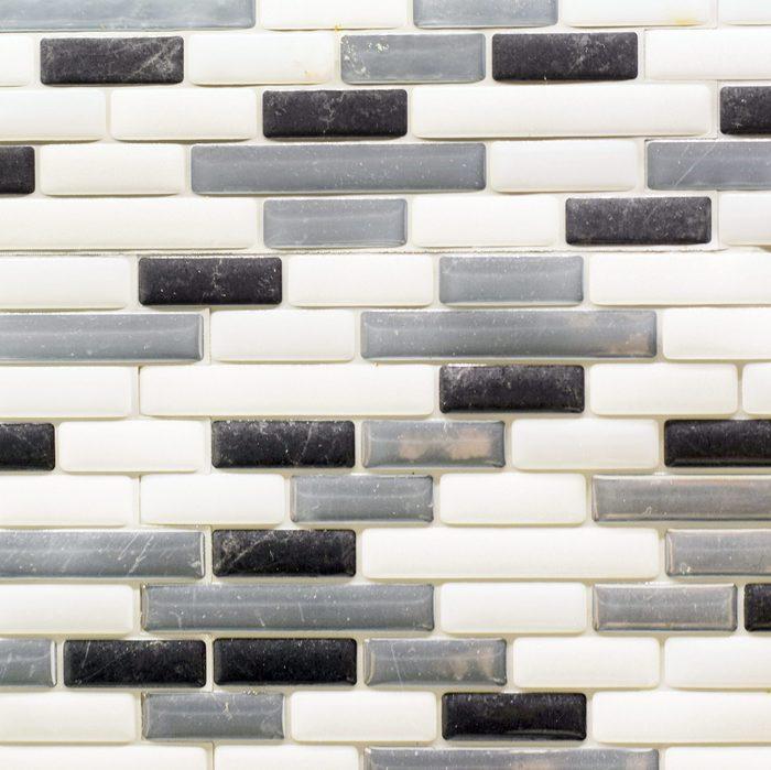 Black white and gray glass tile backsplash in a kitchen