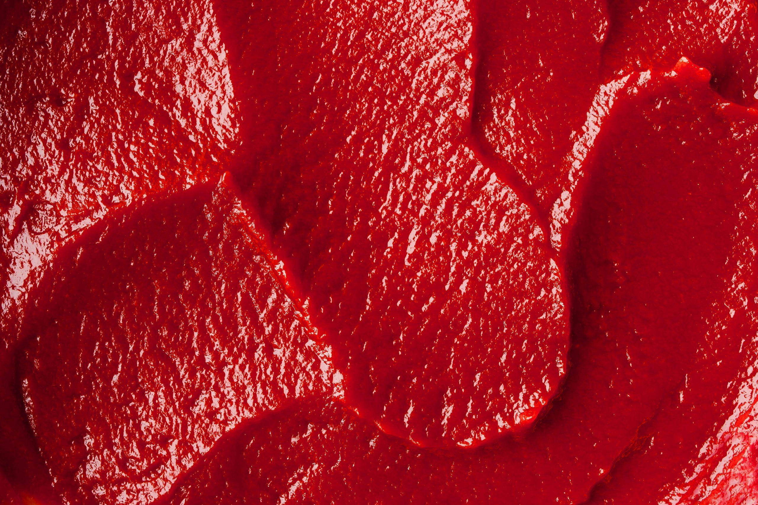 Tomato paste texture close-up horizontal