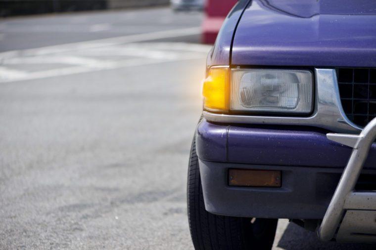 car headlight. car open turn light on freeway.
