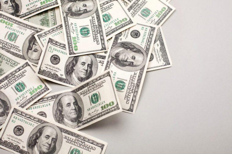 money american hundred dollar bills - horizontal on grey background