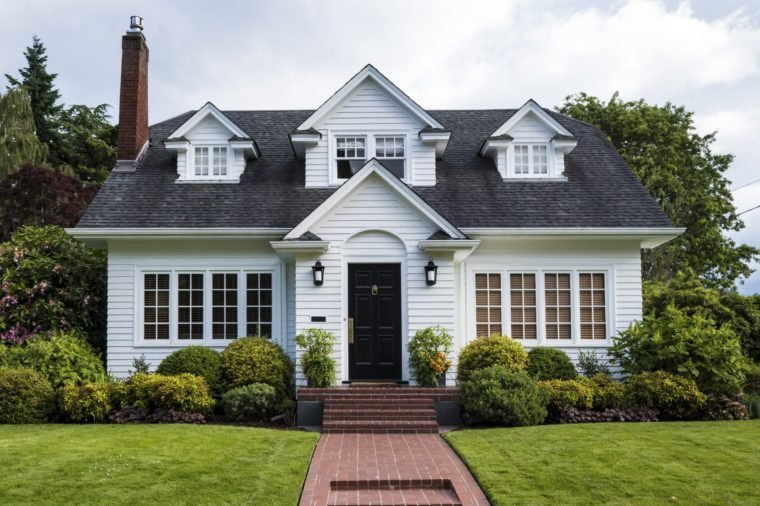 Classic white clapboard house with the red brick sidewalk