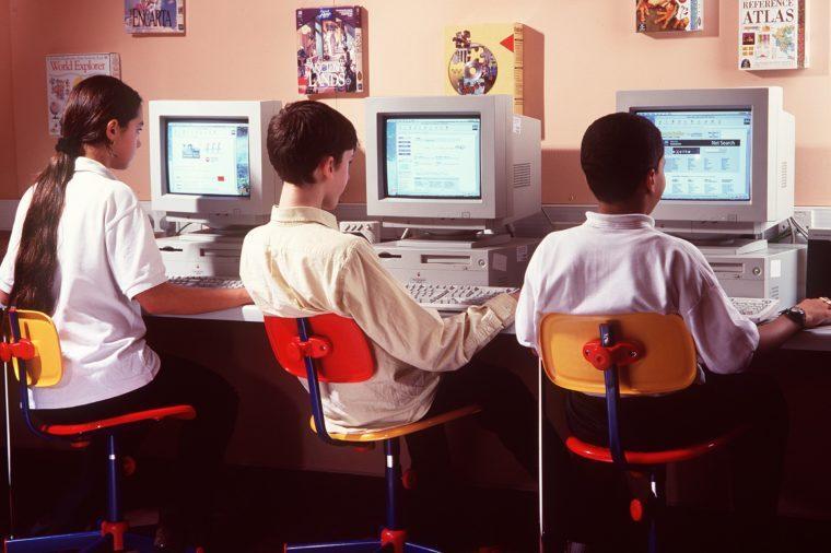 SCHOOL CHILDREN AT COMPUTERS