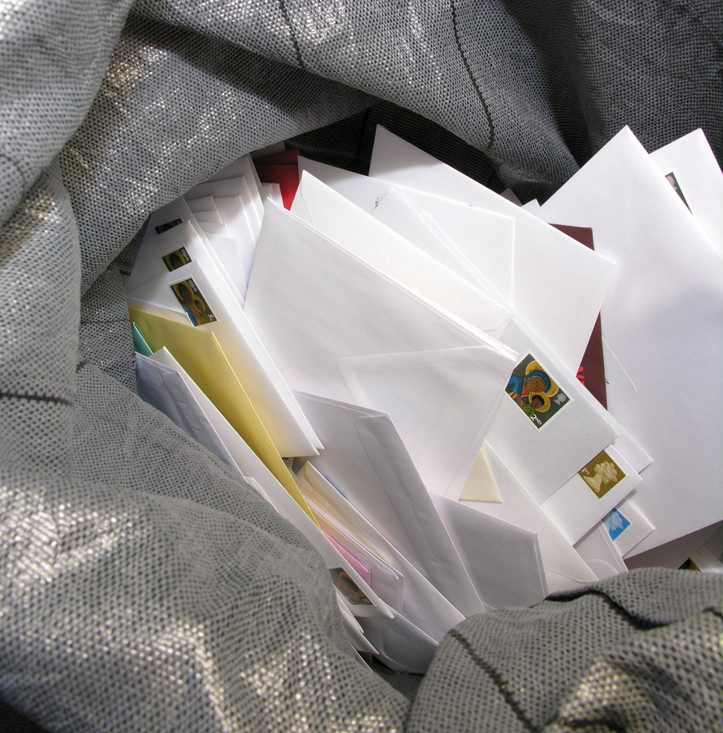 stack of mail in bag