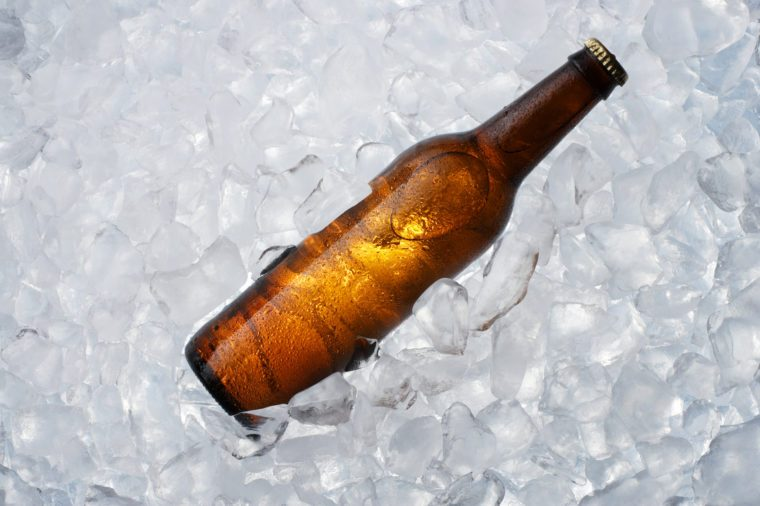 A brown bottle on ice