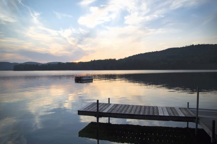 A dock and diving platform at sunset on Little Squam Lake, New Hampshire