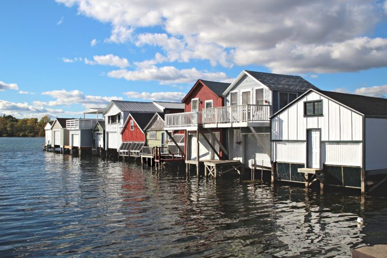 A row of boat houses on Canandaigua Lake in the Finger Lakes region of New York. Boathouses on Canandaigua Lake, New York
