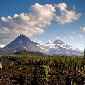 A seemingly endless field of lava leads out to the Sisters near Bend Oregon