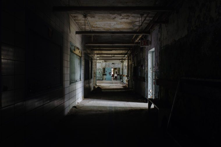 Abandoned, creepy hallway at Creedmoor State Hospital's Building 70 in Queens, New York City, New York.
