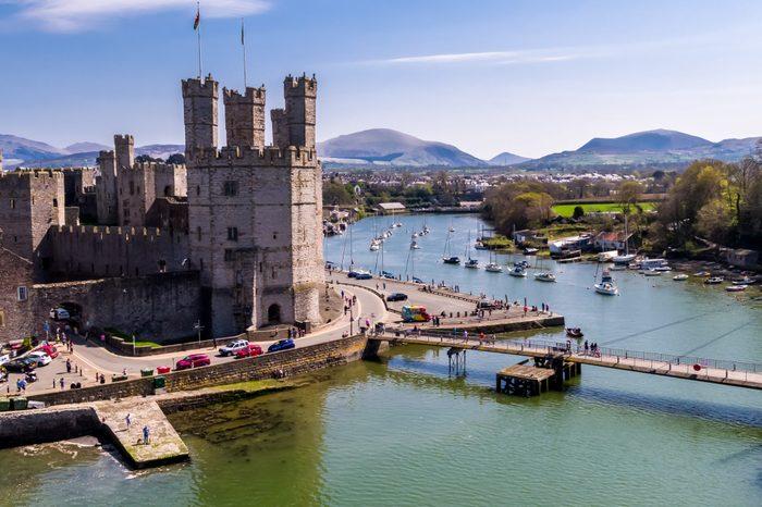 Aerial view of the historic castle Caernafon, Gwynedd in Wales - United Kingdom.