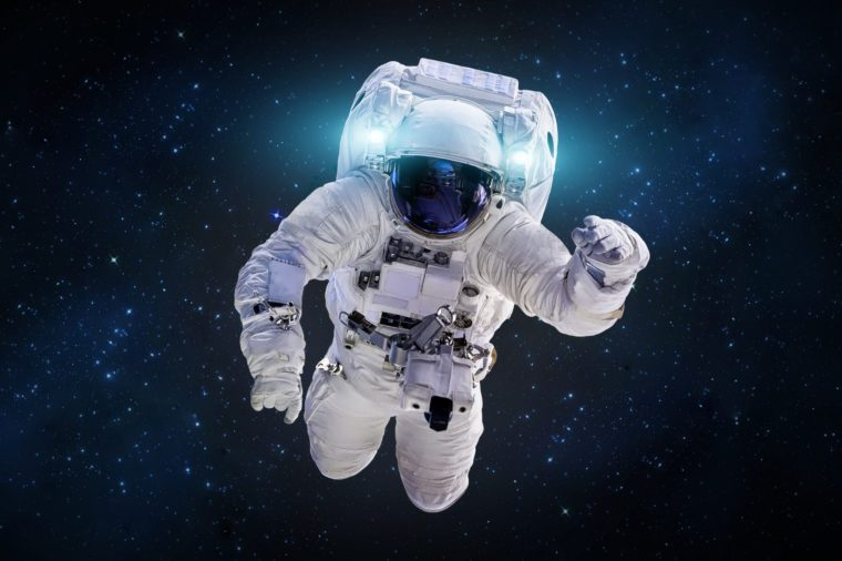 Astronaut in outer space in the deep galaxy. Science theme. Elements of this image furnished by NASA.