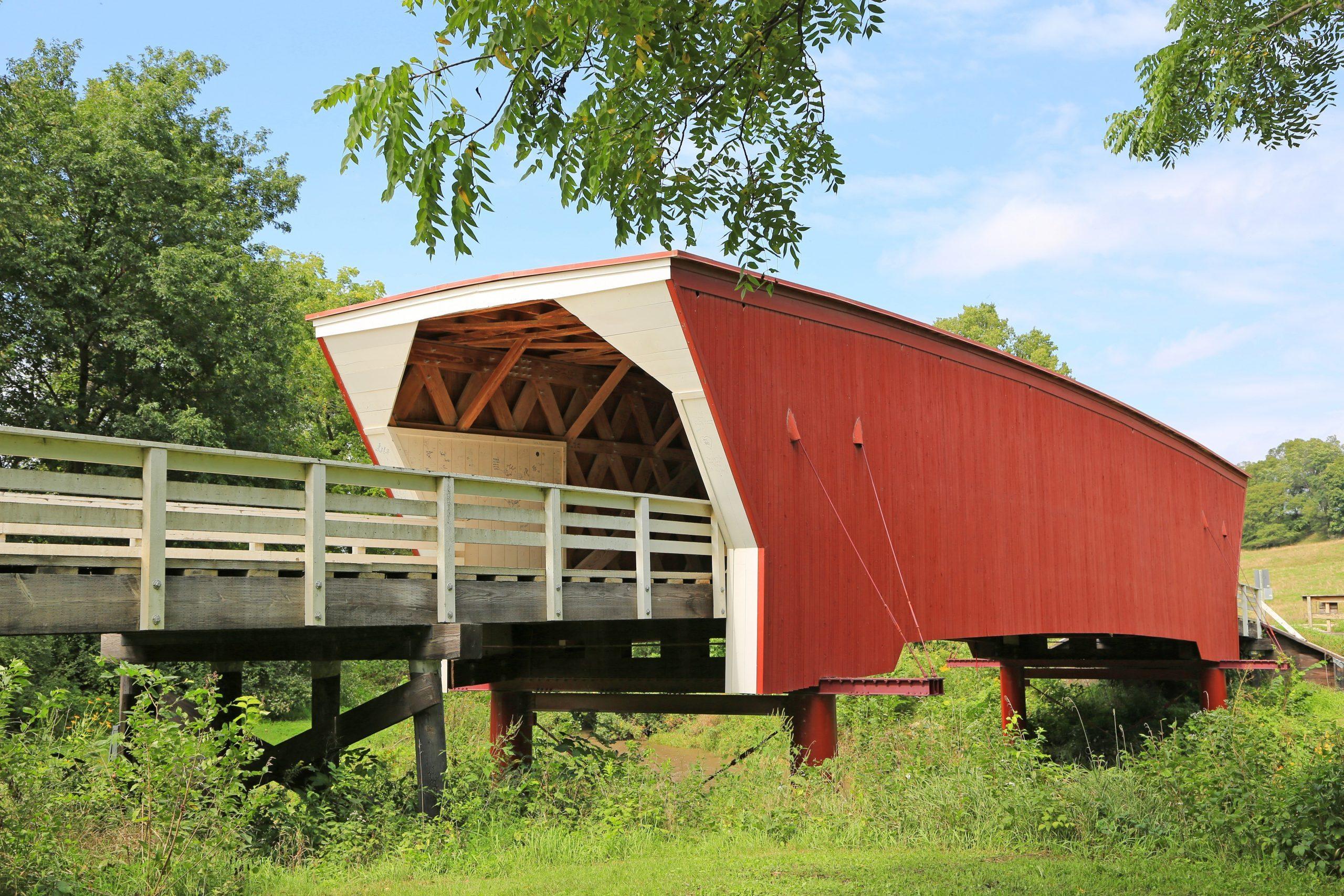 Cedar Bridge under tree - historic covered bridge in Madison County, Iowa