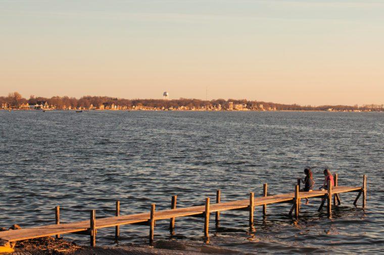 Clear Lake Iowa, Two kids sitting on dock